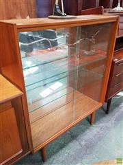 Sale 8566 - Lot 1133 - Vintage Display Case with Two Glass Shelves Two Sliding Glass Doors and Mirrored Back (113 x 29 x 92)