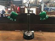 Sale 8882 - Lot 1084 - Antique Style Brass Desk Lamp, having two arms & with green glass bud shaped shades, on reeded brass stem & black base