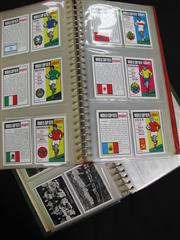 Sale 8125 - Lot 63 - Soccer Cards - 2 albums holding World Cup 1970 cards, a full set of Star Teams 1961 postcards, Ardath Photo Cards, and British Sport...
