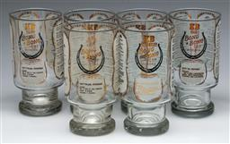 Sale 9168 - Lot 427 - A suite of Bong Bong Cup horse racing themed drinking wares (H:14cm) together with a decade of champions horse racing book