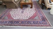 Sale 8310A - Lot 43 - Large Persian Rug with all over floral design in blue red cream and central lozenge. 3m x 4.4m
