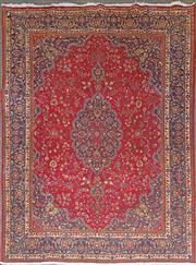 Sale 8653 - Lot 1009 - Persian Kashan Wool Carpet, with blue medallion on a red field (374 x 292cm)