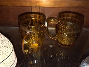 Sale 8759 - Lot 2400 - Pair of Amber Glass with Royals Embossed to Sides