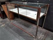 Sale 8834 - Lot 1006 - Elevated Glass Display Case