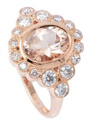 Sale 9054J - Lot 131 - A MORGANITE AND DIAMOND DRESS RING; centring an oval cut morganite of 1.48ct to surround and shoulders set with 16 round brilliant c...