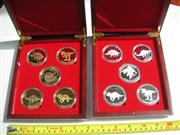 Sale 8064A - Lot 29 - Gold & Silver Plated Dinosaur Coins in Presentation Boxes