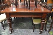 Sale 8291 - Lot 1005 - A Victorian Mahogany Extension Dining Table on turned fluted legs with two leaves (Winder in Office)