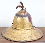 Sale 8800 - Lot 7 - An C17th Tibetan red lacquer and gilt timber helmet with horse hair decoration