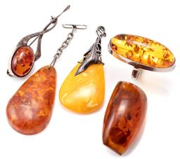 Sale 9124 - Lot 332 - FIVE ITEMS OF AMBER JEWELLERY; sterling silver cocktail ring set with a 40 x 16mm oval cabochon reconstituted amber, stamped WK, siz...