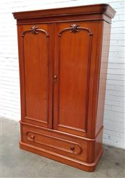 Sale 9085 - Lot 1041 - Late 19th Century Kauri Pine Wardrobe, with two arched carved panel doors, above an oval panel drawer, raised on plinth base - key i...