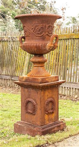 Sale 9191W - Lot 412 - A monumental pair of Cast iron urns on plinths Combined Height  192cm Plinth H. 108cm W.Handle to Handle  700mm Pedestal base 61...