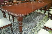Sale 8267 - Lot 1028 - Victorian Style Mahogany Extension Dining Table, with two leaves & on turned reeded legs (Winder in Office)