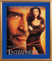 Sale 8677B - Lot 885 - A gilt framed movie poster Entrapment 102 x 89cm.