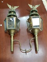 Sale 8714 - Lot 1082 - Pair of Ornate Brass Carriage Lamps, the hexagonal bodies with tiered tops surmounted by eagles