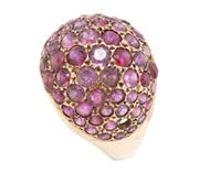 Sale 8915 - Lot 307 - A VINTAGE 18CT GOLD RUBY RING; dome top set with round cut rubies (1 missing), size P 1/2, wt. 5.56g.