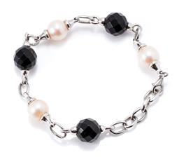 Sale 9182 - Lot 325 - A SILVER PEARL AND ONYX BRACELET; 3 x 10.5mm round cultured pearls and 3 x 11.5mm faceted onyx beads links to parrot clasp, length 2...