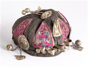 Sale 8890T - Lot 23 - A childs near Eastern cap, embroidered in panels with applied silver bells