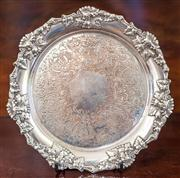 Sale 8284A - Lot 45 - An antique silverplate on copper tray with grape and vine border, 1880's. D: 21cm
