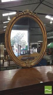 Sale 8402 - Lot 1094 - Victorian Gilt Gesso Oval Mirror with Beaded and Scrolled Frame