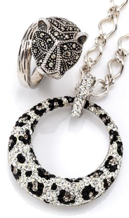Sale 9132 - Lot 584 - SILVER LEAOPARD PENDANT NECKLACE AND RING; 34mm wide tapered ring set with black and white crystals in leopard print pattern (some m...