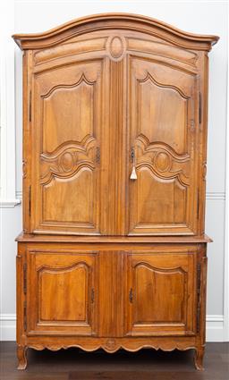 Sale 9160H - Lot 117 - An antique French fruitwood armoire with two cupboard doors opening to reveal shelved interior, over two doors opening to reveal sin...