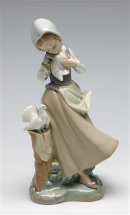 Sale 9253 - Lot 196 - A Lladro figure of a girl with doves (H:22cm)