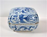 Sale 8402H - Lot 14 - Wanli period style blue & white box, painted with dragon and phoenix amongst clouds. Wanli six character mark to base.