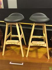 Sale 8643 - Lot 1186 - A pair of Buch style stools with black padded seat, each height 76cm - as new