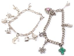 Sale 9132 - Lot 332 - TWO SILVER CHARM BRACELETS; a 5mm wide curb links to pierced heart padlock clasp set with a zirconia attached with 3 silver charms,...