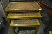 Sale 8305 - Lot 1098 - Nest of Three Tables with Copper Style Tops