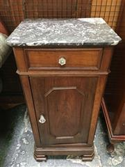 Sale 8666 - Lot 1014 - 19th Century French Walnut Bedside Cabinet, with black marble top, a drawer & panel door