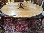 Sale 8774 - Lot 1038 - 19th Century French Rustic Walnut Wine Tasting Table, the round tilt-top on folding base (old borer damage)