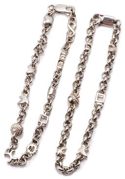 Sale 9132 - Lot 365 - TWO MATT WISE SILVER CHARM BRACELETS; both cable link chains to parrot clasps with Wise stamps, set with 6 and 11 charms, lengths 19...