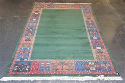 Sale 9174 - Lot 1005 - Contemporary green field carpet with colourful border (360 x 250cm)