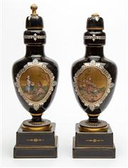 Sale 8590A - Lot 7 - A pair of garniture baluster lidded vases, painted with scenes of youths, damage to one finial, H 45cm