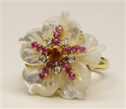 Sale 8036A - Lot 316 - A 14CT WHITE GOLD FLOWER RING; featuring a mother of pearl floral bloom centring a citrine surrounded by pink sapphires and round br...