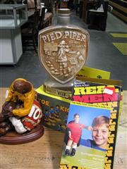 Sale 8125 - Lot 67 - Great Sporting Moments! Tackling footballers statue, Munich 1974 Jim Beam Bottle, mint Toe-Kicker game & Real Men!