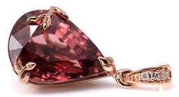 Sale 9124 - Lot 503 - A 9CT ROSE GOLD ZIRCON AND DIAMOND PENDANT; featuring an approx. 15.6ct pear cut pink zircon with leaf form claws to a bale set with...