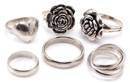 Sale 9132 - Lot 363 - SIX SILVER RINGS; 2 rose blooms, size N & O1/2, a Russian triband ring, size I, a heart, size O1/2, and 2 bands, sizes L & Y, total...