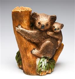 Sale 9255S - Lot 64 - A composite figural group of Koalas on tree stump Height 31cm