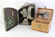 Sale 8761 - Lot 65 - Bell and Howell 8mm Camera and Projector, both in original cases