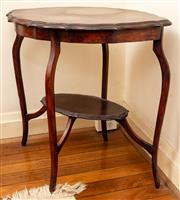 Sale 8882H - Lot 29 - An Edwardian maple occasional table with an oval scalloped top and lower tier. Height 72cm x 72cm x 50cm