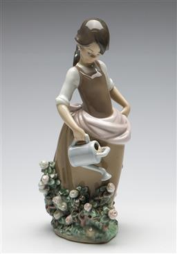 Sale 9253 - Lot 198 - A Lladro girl with watering can in the roses (H:29cm)