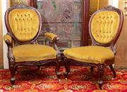Sale 8804A - Lot 37 - A Victorian carved walnut ladies and gentlemen chair upholstered in gold button velvet ensuite to settee