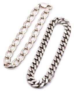 Sale 9132 - Lot 470 - TWO GENTS SILVER BRACELETS; 8mm wide fancy curb link chain to parrot clasp, and filed curb links to integrated clasp, both 20.5cm lo...