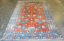 Sale 9174 - Lot 1368 - Robin Cosgrove Persian style red and blue carpet (390 x 273cm)