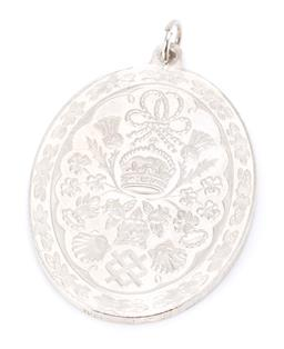 Sale 9169 - Lot 390 - A HALLMARKED 1981 SILVER COMMEMORATIVE PENDANT; Prince Charles & Lady Diana medallion, size 39.5 x 28mm, wt. 14.25g.