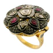 Sale 8060B - Lot 370 - A STERLING SILVER GILT COCKTAIL RING; set with rubies (treated), single and table cut diamonds. Size R