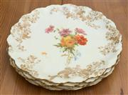 Sale 8470H - Lot 166 - A set of four Royal Doulton Burslem printed and painted cake plates with gilt rim