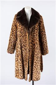 Sale 8760F - Lot 174 - A vintage leopard print faux-fur coat with belt, size 12